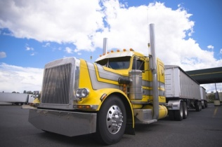 Yellow classic custom semi truck with two bulk trailers