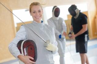 Portrait of smiling female fencer