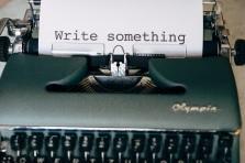 Typewriter with text saying write something