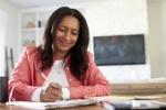 Woman writing at a table